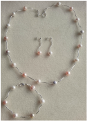 Custom made freshwater pearl necklace, bracelet and earring set.